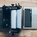 typewriter and laptop computer