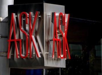 """Metal cube with """"ask"""" in red letters on too sides"""