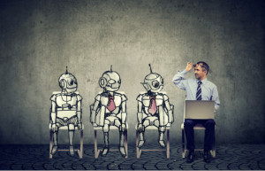 three robots and a man sitting in a row